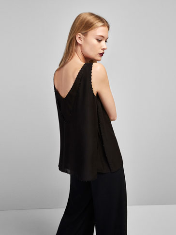 DOUBLE LAYER TOP WITH STONE DETAILS