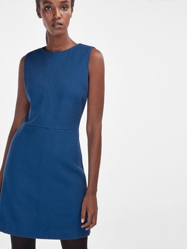 BLUE DRESS WITH A TEXTURED DETAIL