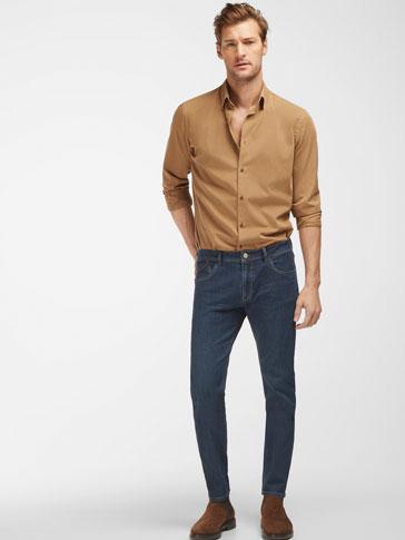 سروال جينز باهت بجزئية المغسول