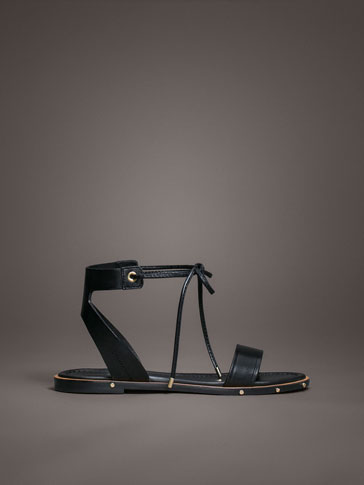 LIMITED EDITION FLAT SANDALS WITH APPLIQUÉS