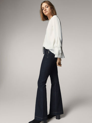FLARED JEANS WITH ZIP DETAIL