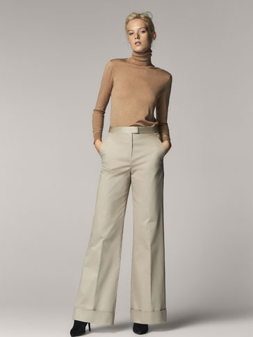 TROUSERS WITH TURN-UP CUFFS DETAIL
