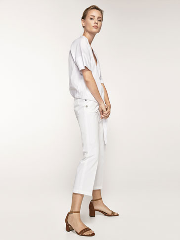CROPPED FIT TROUSERS WITH BUTTON DETAIL