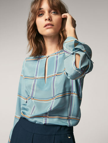 CHECKED SILK SHIRT WITH FLARED DETAIL