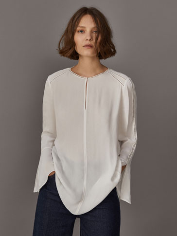 LACE-TRIMMED OVERSIZED BLOUSE WITH RUFFLED SLEEVES