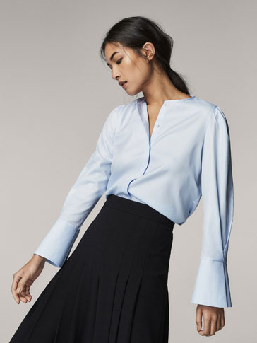 SKY BLUE SHIRT WITH FLARED DETAIL