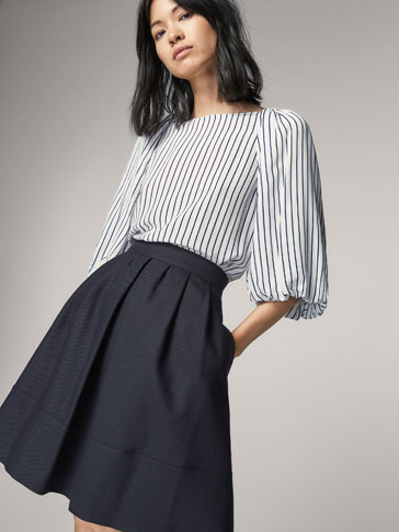 SKIRT WITH PLEATED DETAIL