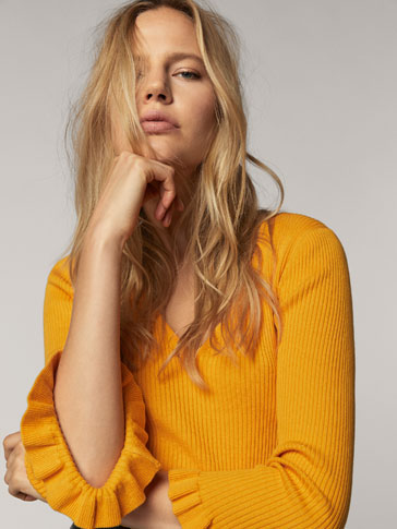RIBBED SWEATER WITH RUFFLED DETAIL