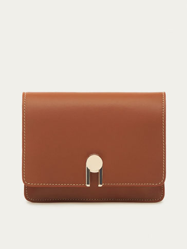 LEATHER CROSSBODY BAG WITH ROTATING DETAIL
