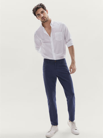 CASUAL FIT PIQUÉ CHINO TROUSERS