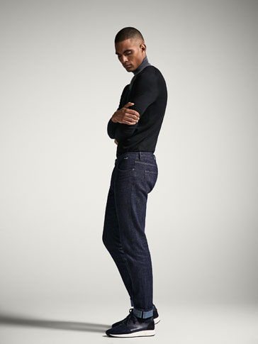 SLIM FIT RUSTIC JEANS WITH SELVEDGE DETAIL
