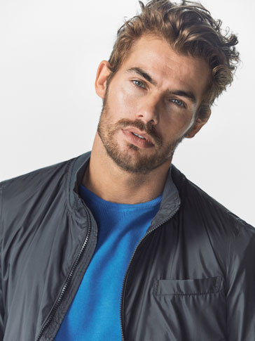 BOMBER-STYLE JACKET WITH FOLDABLE DETAIL
