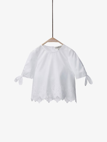 WHITE SHIRT WITH BOWS DETAIL
