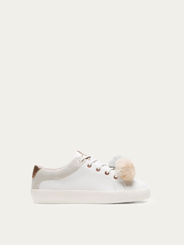 WHITE LEATHER PLIMSOLLS WITH POMPOM DETAIL