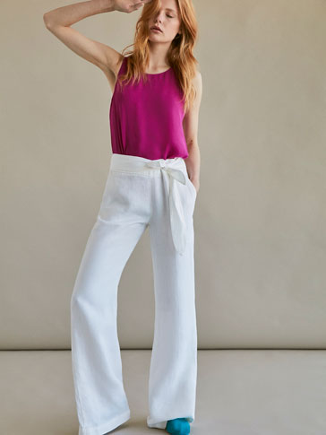 FLARE FIT LINEN TROUSERS WITH TIE DETAIL
