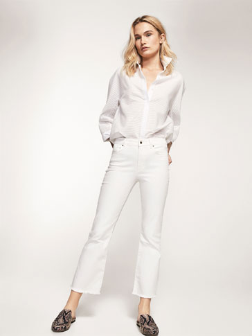 WHITE CROPPED FIT JEANS WITH FRAYED EDGE DETAIL