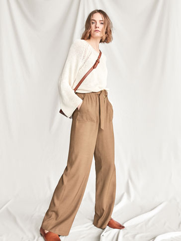 TROUSERS WITH RING DETAIL