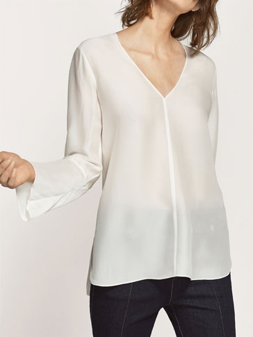 LARGE BLOUSE WITH TEXTURED WEAVE AND SLEEVE DETAIL