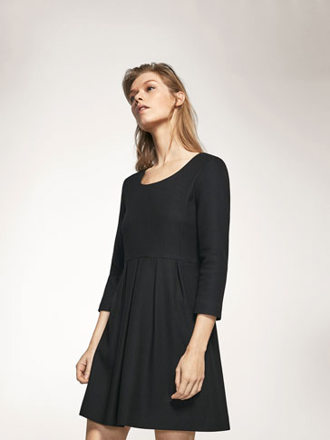 PLEATED DRESS WITH A TEXTURED WEAVE