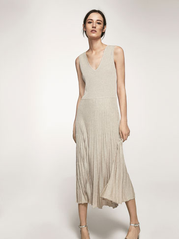 KNIT DRESS WITH PLEATED DETAIL ON HEM