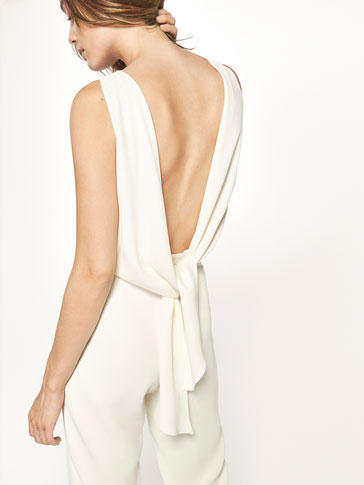 WHITE JUMPSUIT WITH BOW DETAIL