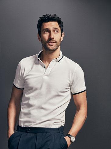 قميص بولو مخطط متباين إصدار محدود