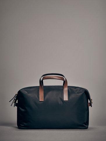 حقيبة جلد ممزوج تقني إصدار محدود