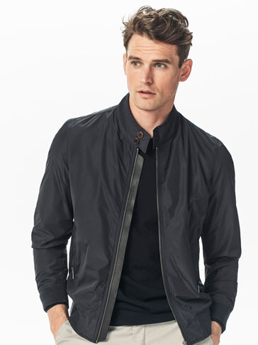 TECHNICAL JACKET WITH A LEATHER DETAIL