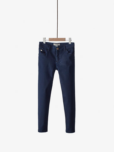 SLIM FIT JEANS WITH PIPING DETAIL