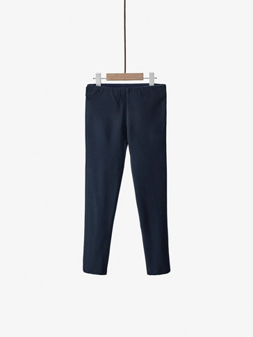 LEGGING-STYLE TROUSERS WITH BUTTON DETAIL