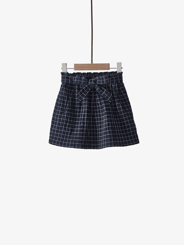 CHECKED SKIRT WITH TIE DETAIL