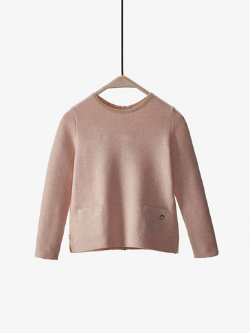 SWEATER MED METALLISERET KANT