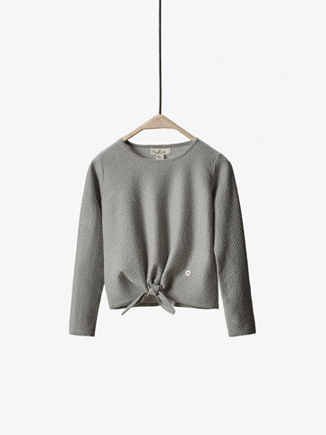 TEXTURED SWEATER WITH SPARKLES AND A KNOT