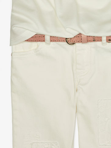 BELT WITH PERFORATIONS