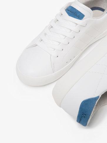 حذاء بليمسول جلد خياطة أبيض