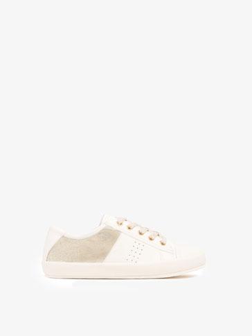 حذاء بامبا أبيض زهبي