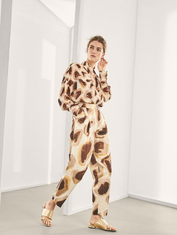 LIMITED EDITION GIRAFFE PRINT TROUSERS