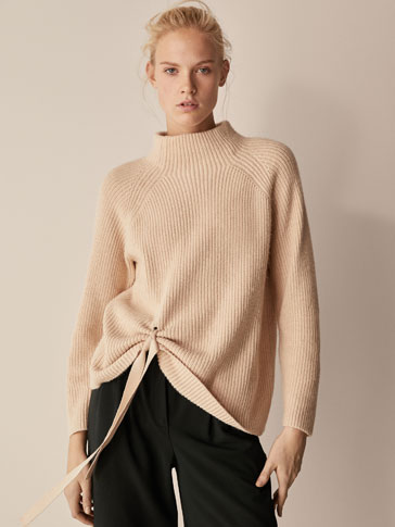 BRIOCHE STITCH SWEATER WITH SIDE BOW DETAIL