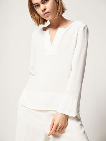 CONTRASTING TOP WITH RUFFLED CUFFS