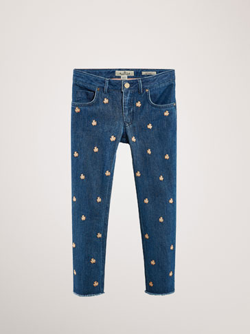REGULAR FIT JEANS WITH EMBROIDERED FLOWERS