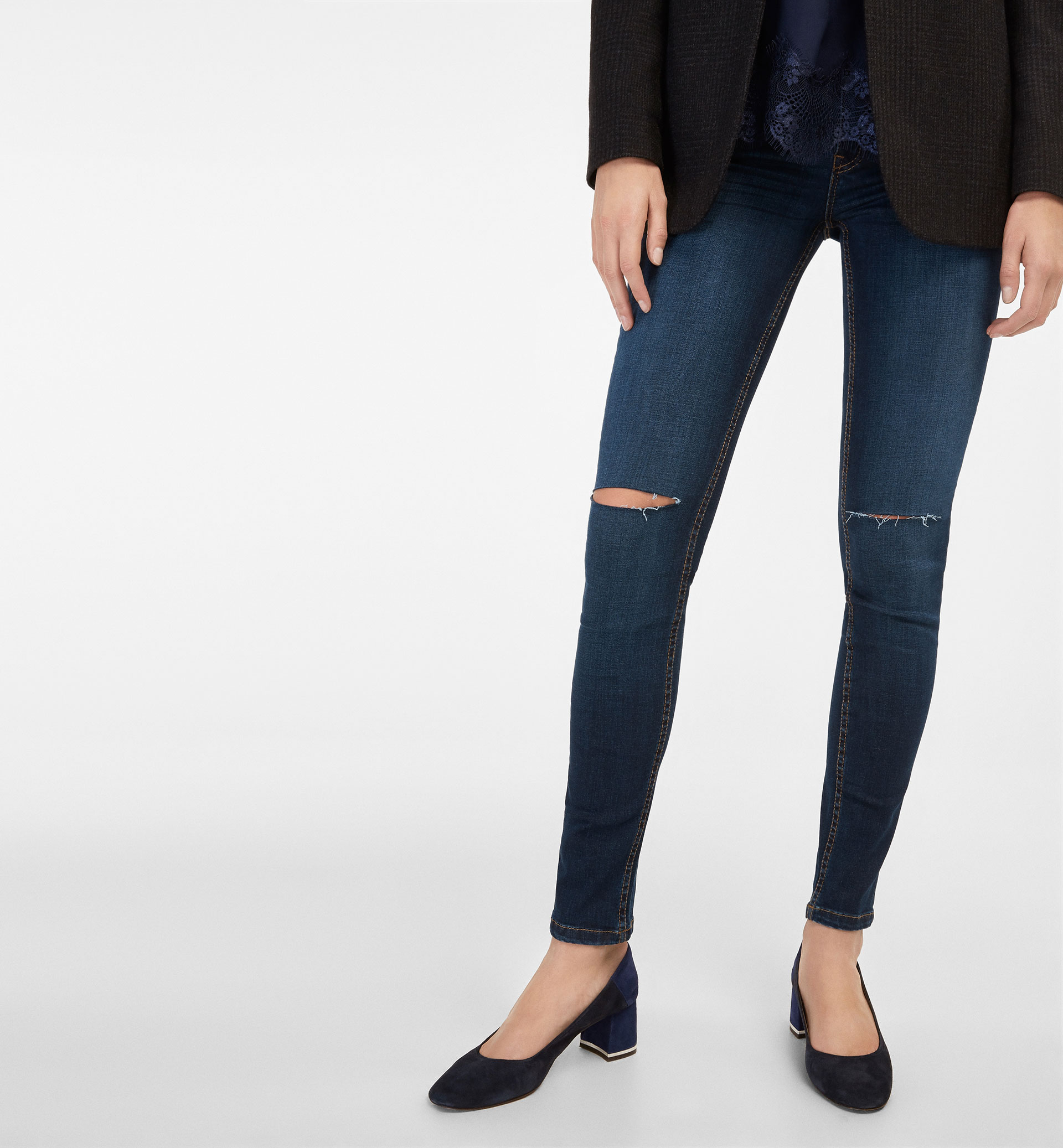 SUPERSKINNY FIT JEANS WITH RIPPED KNEES
