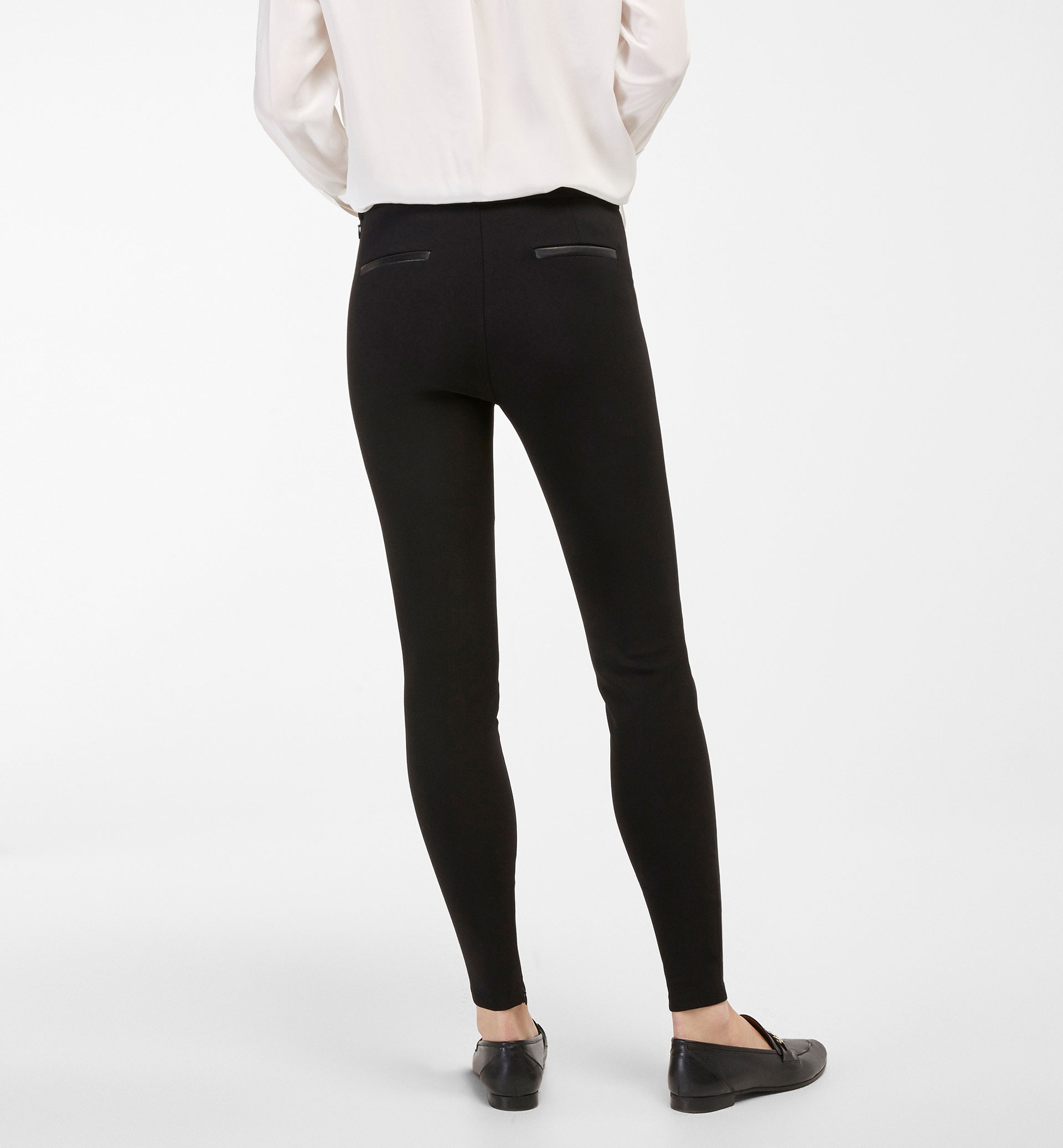 LEGGINGS WITH LEATHER DETAIL