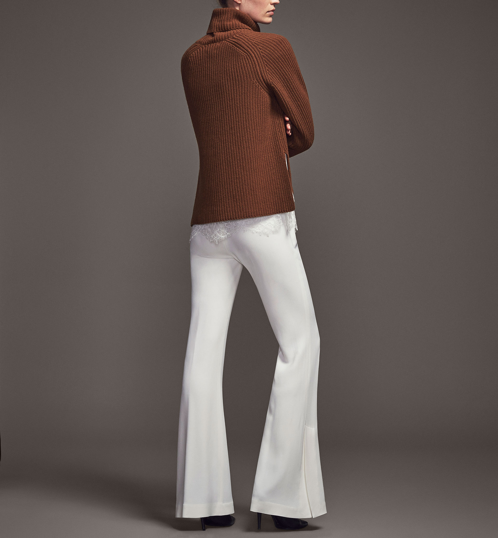LIMITED EDITION WHITE TROUSERS WITH SLIT DETAIL
