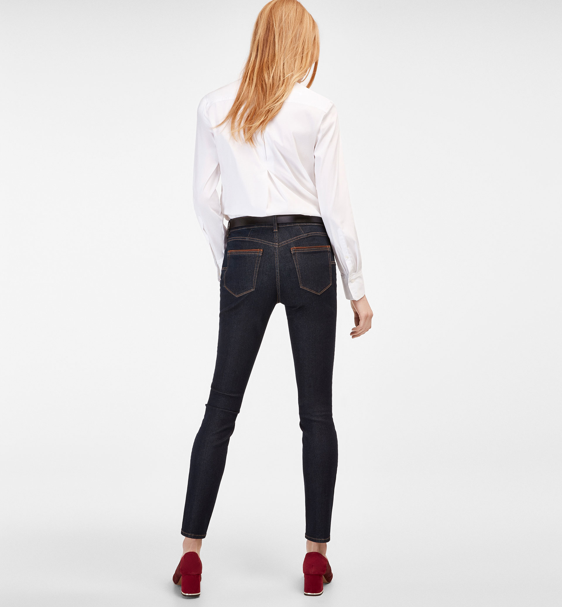 SKINNY JEANS WITH LEATHER DETAIL