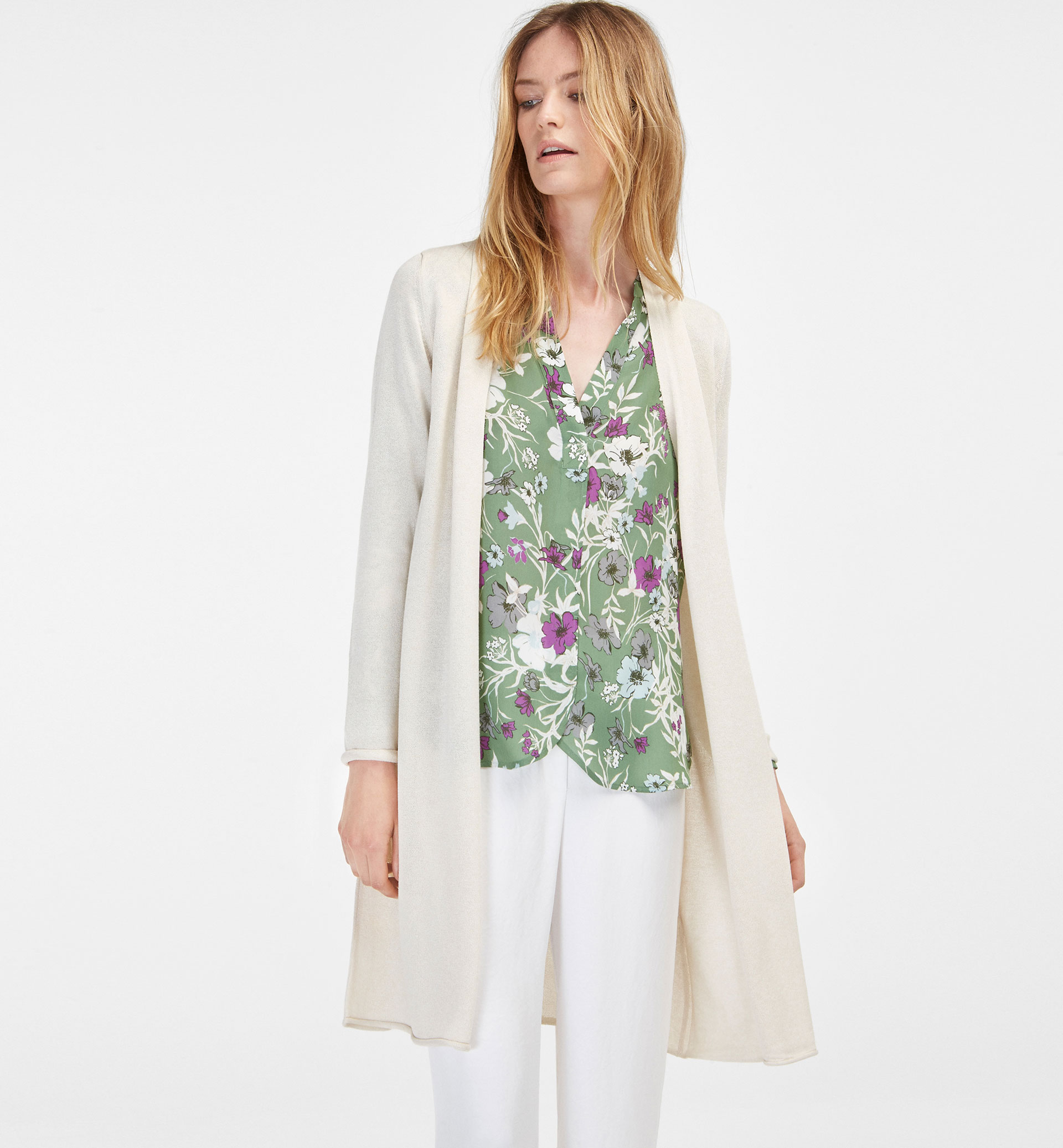 TEXTURED WEAVE CARDIGAN WITH PLEAT DETAIL AT THE BACK