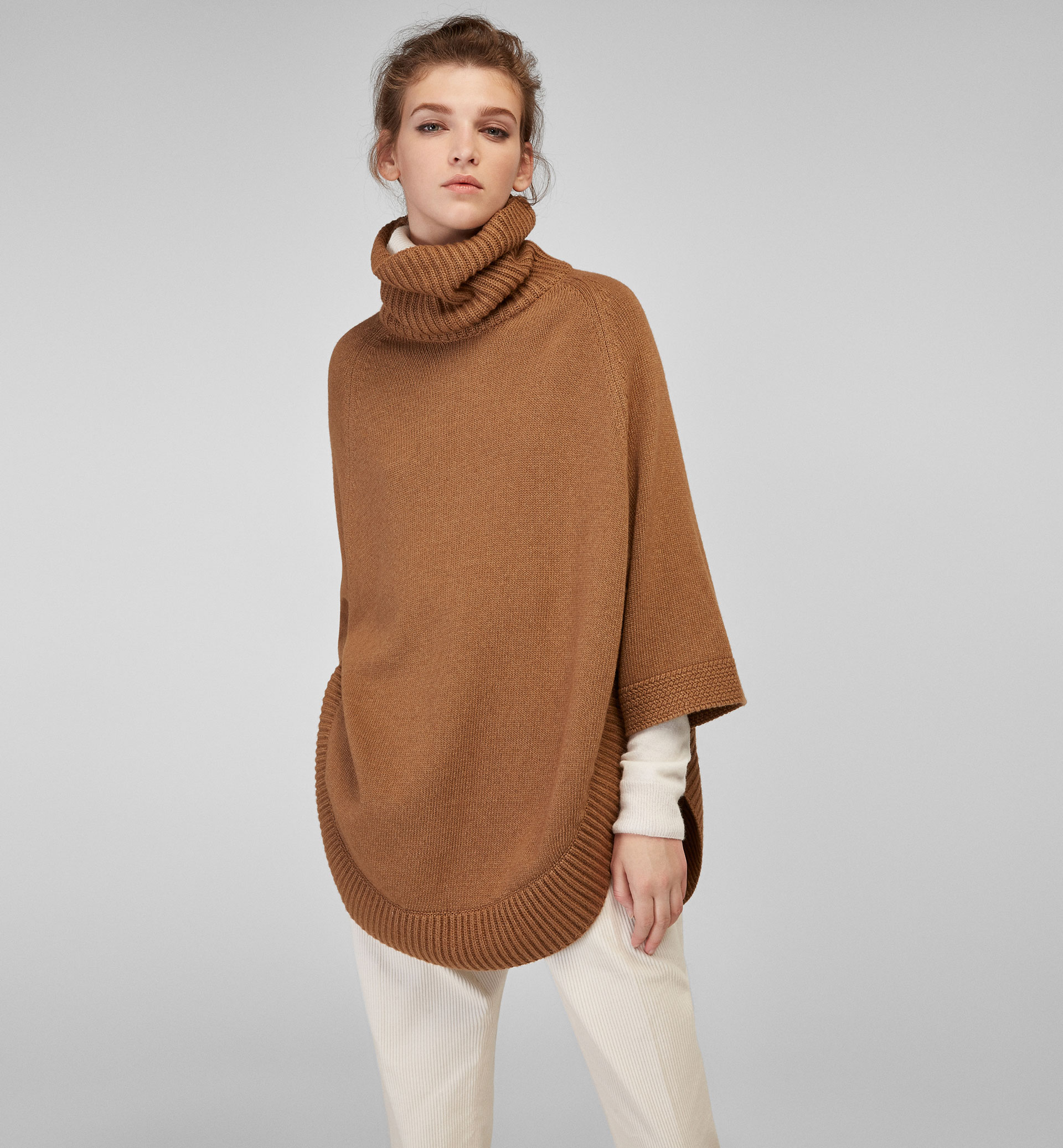 CAPE-STYLE SWEATER WITH ROUNDED HEM