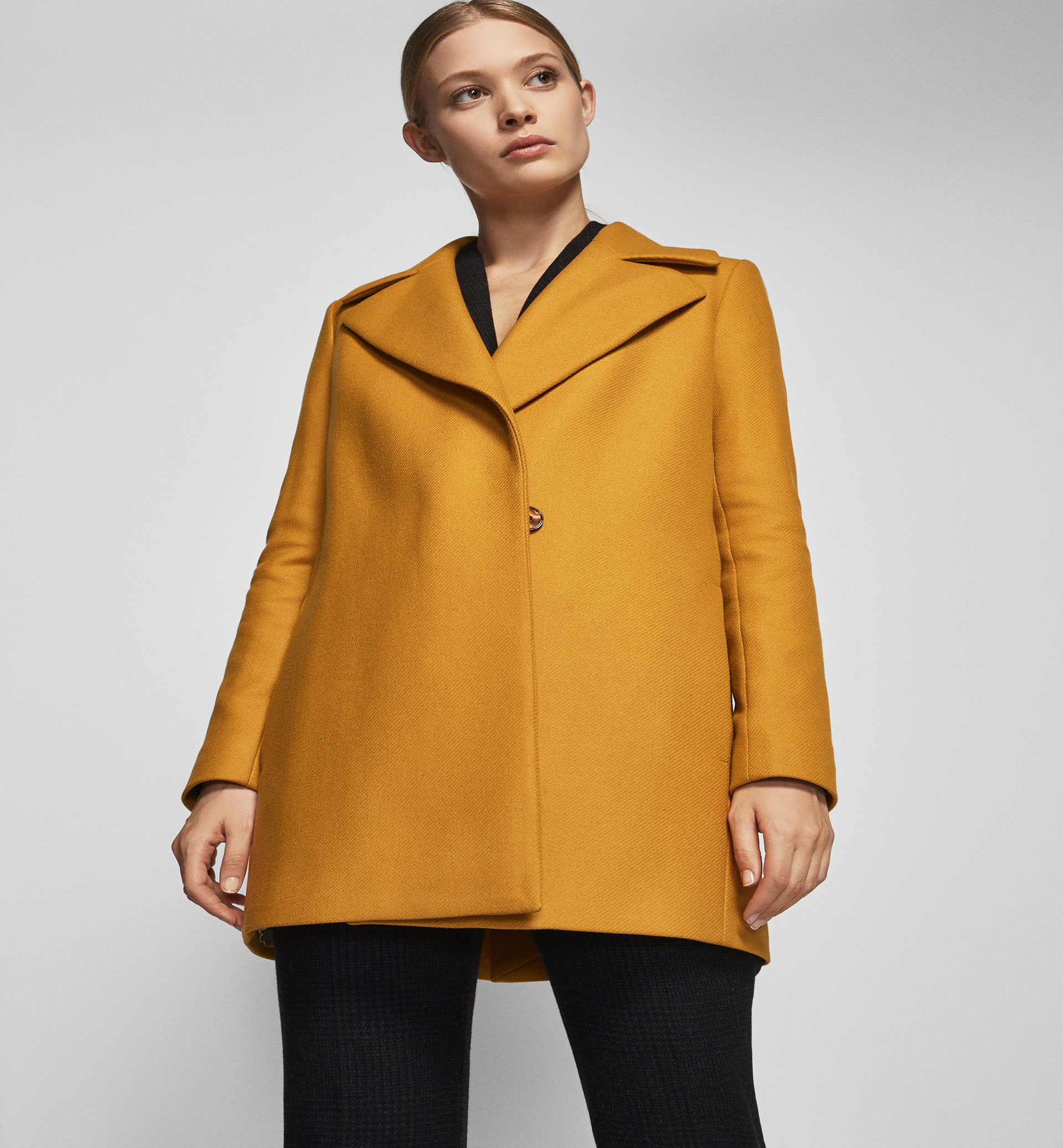 MUSTARD COLOURED COAT WITH FLAP DETAIL