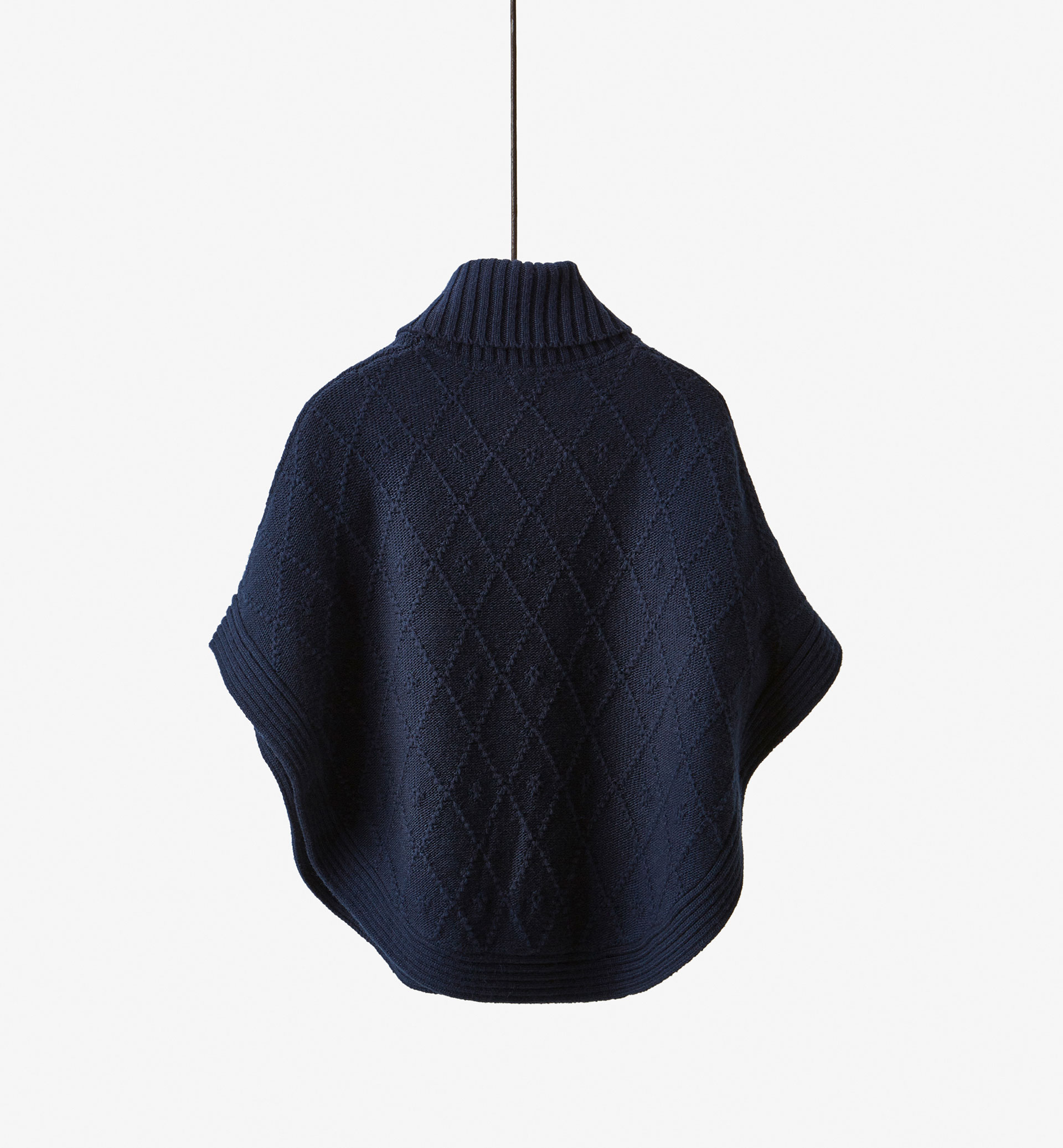 KNIT CAPE WITH BUTTON DETAIL
