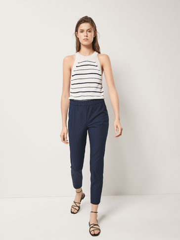 SKINNY FIT TROUSERS WITH SIDE SLITS