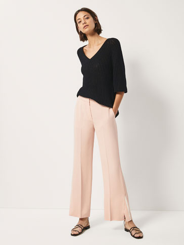 FLARED TROUSERS WITH SIDE SLITS